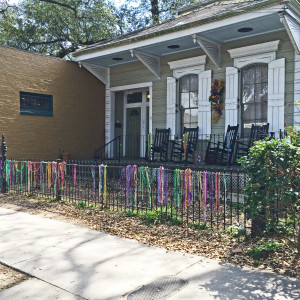Mardi Gras beads hung on fence