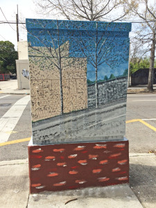 Sidewalk view of painted utility box is another scene