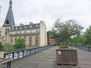Le Promenade Planteé (Paris High Line)  one of the few areas with railroad walls and boards