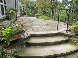 Round containers on either side of arching steps