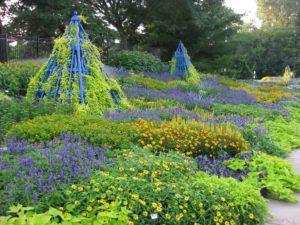 Blue obelisk in blue-chartreuse garden