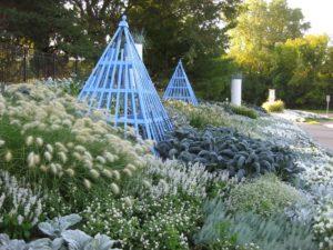 Blue obelisk in gray-white garden