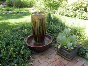 Ceramic urn in basin