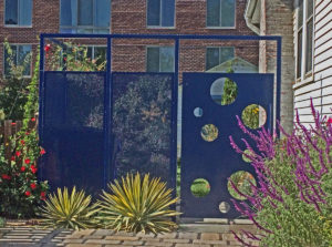A blue metal door and Eco-Mesh fence in a Virginia suburb